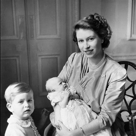 1145 Prince Andrew with Queen Elizabeth II who is holding ...