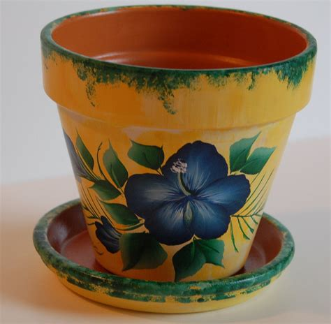 6   or 8   Hand Painted clay flower pot