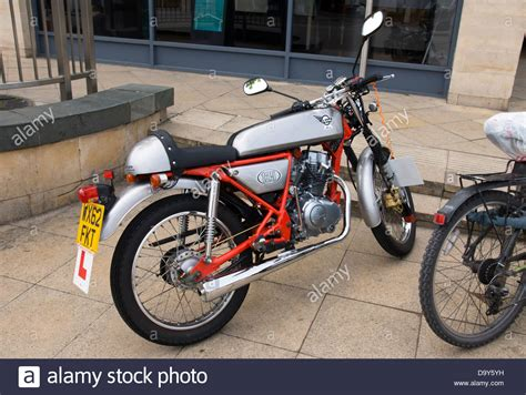 A 125cc Motor Bike in the Style of a 1960 s Cafe Racer. A ...