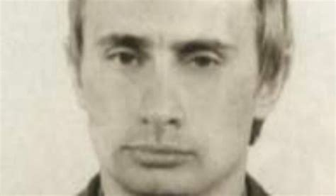A young Vladimir Putin is shown in this photo of him as a ...