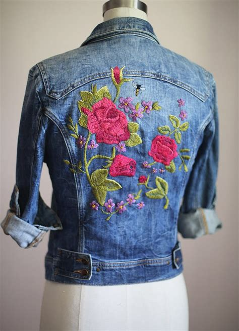 Another take on floral embroidery on a denim jacket. An ...