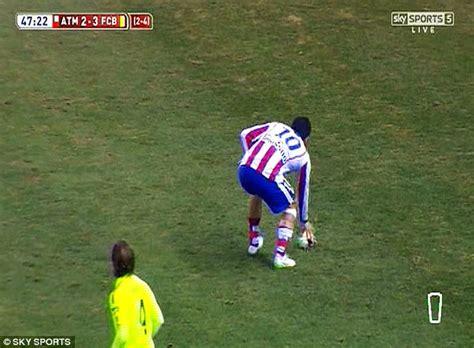 Arda Turan hurls his boot at a linesman during Atletico ...