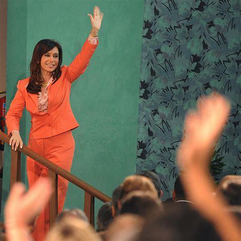 Argentinian President Cristina Fernandez de Kirchner waves ...