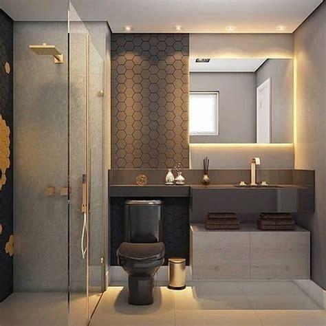 Banheiro lindíssimo em tons de cinza e preto, com metais ...