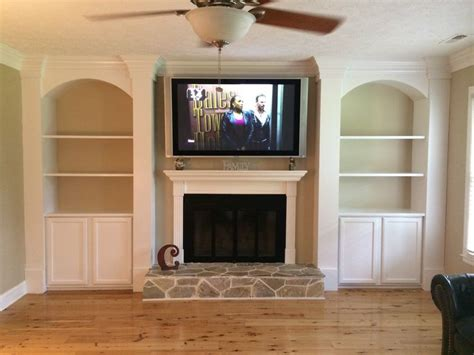 Cabinet and shelves beside fireplace.   Fireplace shelves ...