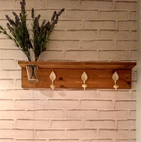 Características de perchero madera con florero de ...