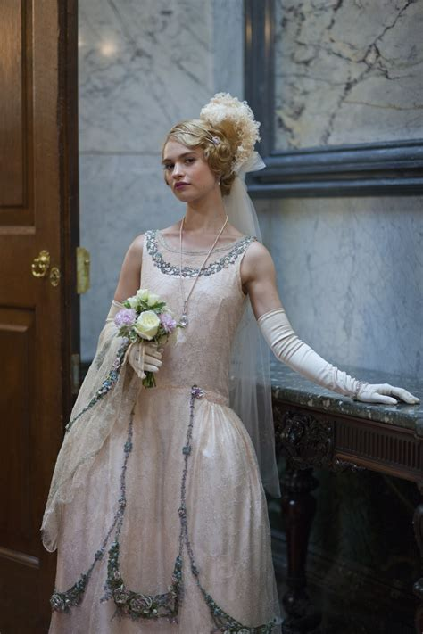 Celebrities in Gloves — Lily James wearing opera gloves in ...