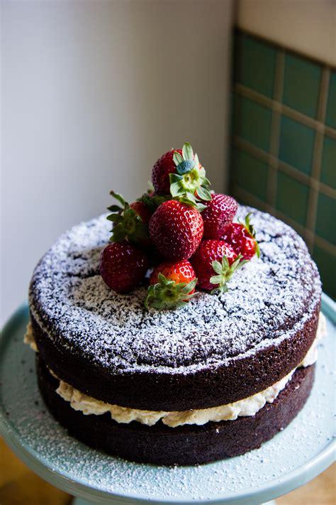 Chocolate celebration cake with strawberries and cream ...