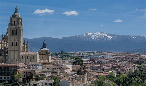 Cityscape of Madrid with Mountain landscape in Background ...