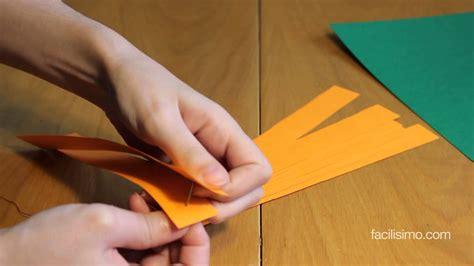 Cómo hacer una calabaza de papel para Halloween ...