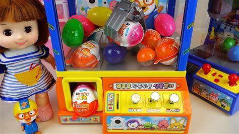 Crane Surprise eggs Kinder Joy toys and Baby doll Pororo ...