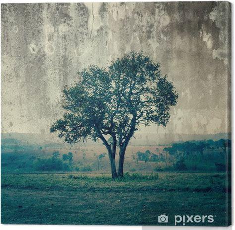 Cuadro en Lienzo Un solo árbol representa la soledad y la ...