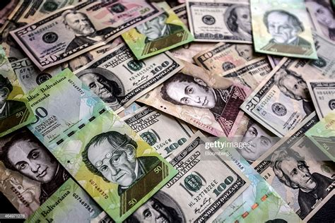 Currency Illustrations As Bolivar Weakens Against the ...