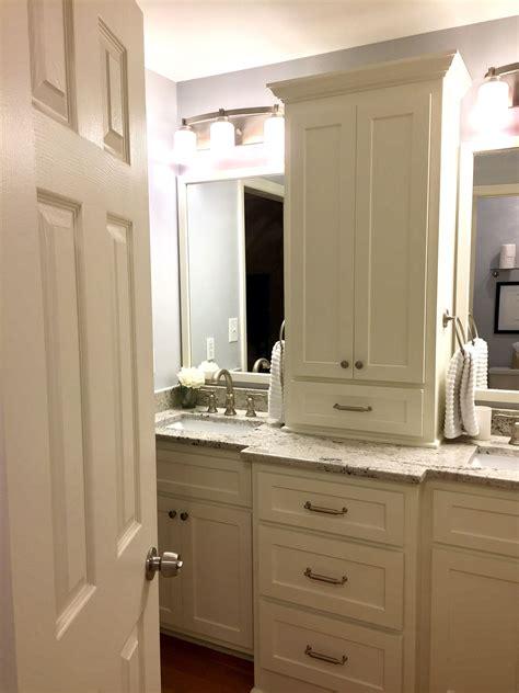 Custom built vanity with storage tower and granite ...