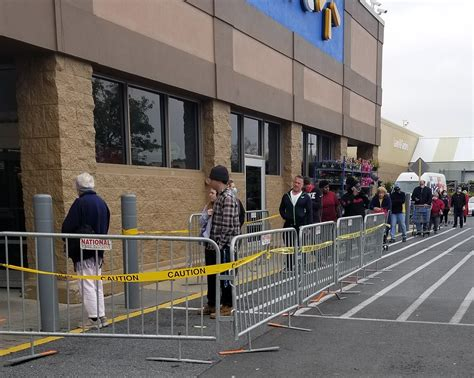Customers at a Walmart in Rehoboth Beach, Delaware wait in ...