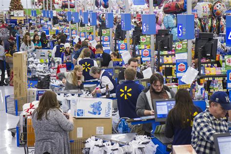 Customers wrap up their holiday shopping during Walmart s ...