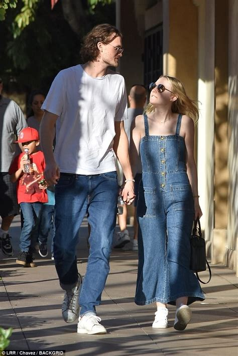 Dakota Fanning holds hands with Henry Frye in Los Angeles ...