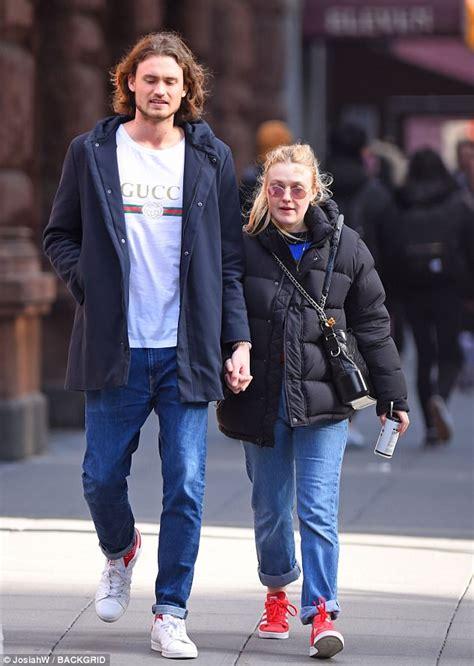 Dakota Fanning holds hands with Valentine Henry Frye in NY ...