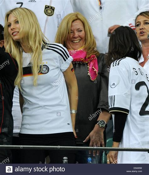 Daniela Loew  C with pink scarf , the wife of German ...