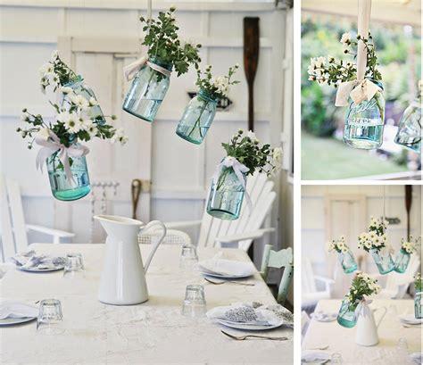 Decorar la mesa con tarros de cristal colgados | Decoración