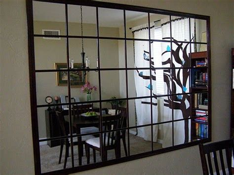 DIY Mirrored Wall using IKEA Lots mirrors. If only we had ...