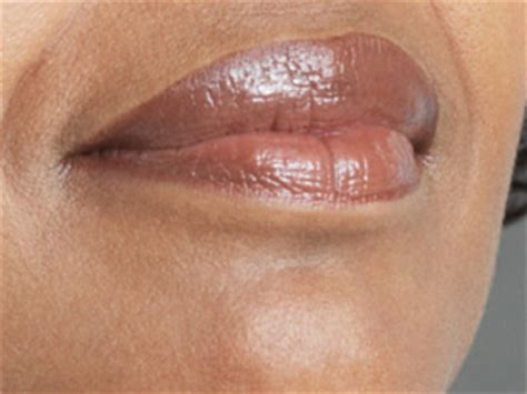 Does lip gloss increase the risk of skin cancer?   CNN.com