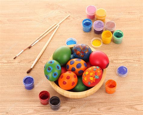Easter eggs, color paint and brushes — Stock Photo ...