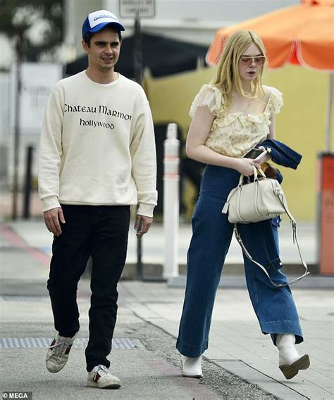 Elle Fanning, 20, is joined by rumoured boyfriend Max ...