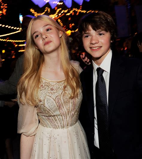 Elle Fanning and Joel Courtney Photos Photos   Premiere Of ...
