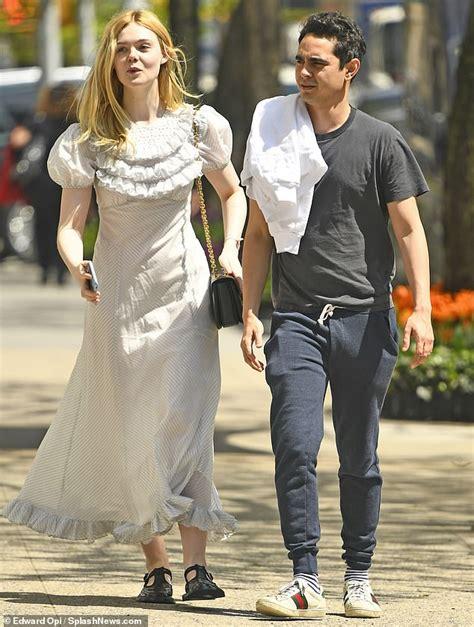 Elle Fanning looks happy with rumored boyfriend Max ...