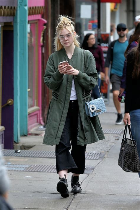 Elle Fanning Walks home after lunch with her mother ...