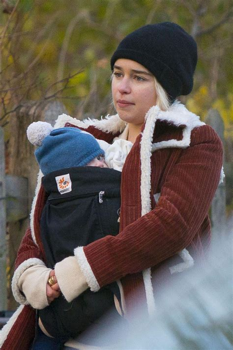 Emilia Clarke Cradles her newborn godson for a walk around ...