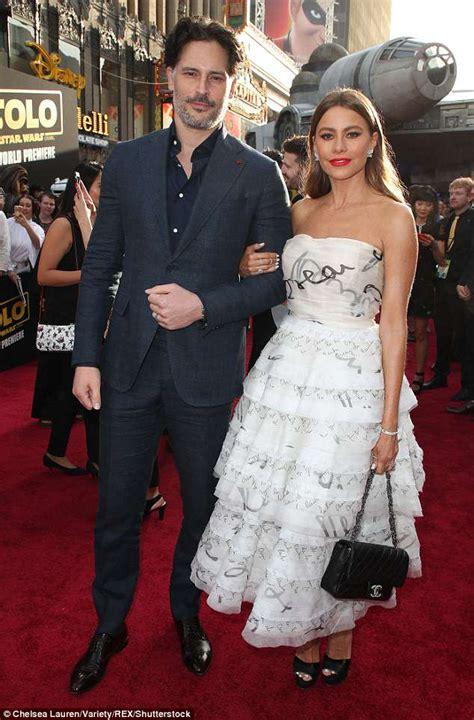 Emilia Clarke enchants in ruby red gown with Alden ...