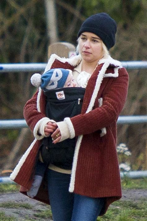 emilia clarke enjoys a walk with her newborn godson around ...