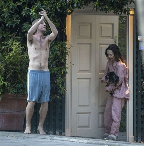 EMILIA CLARKE in Pyjamas with Her Dog Outside Her House in ...