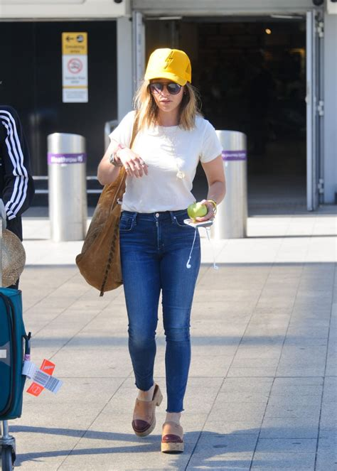 Emilia Clarke Travel Outfit   London s Heathrow Airport ...