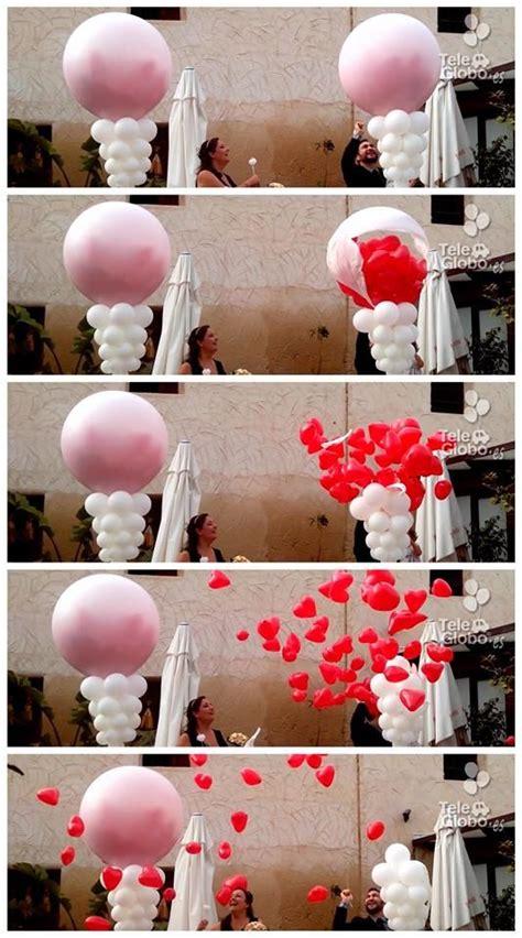 Explosión de globos con suelta de corazones   Globos para ...