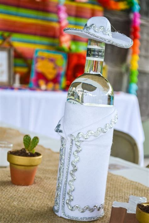 Fiesta decor. Charro dressed tequila bottles | Parties ...