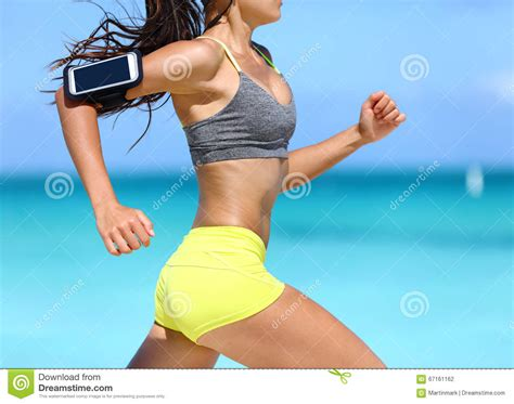 Fitness Woman Running Fast Wearing Phone Armband Stock ...