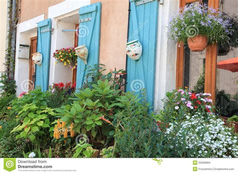 Flowers And Plants Decorating House Exterior. Stock Photo ...