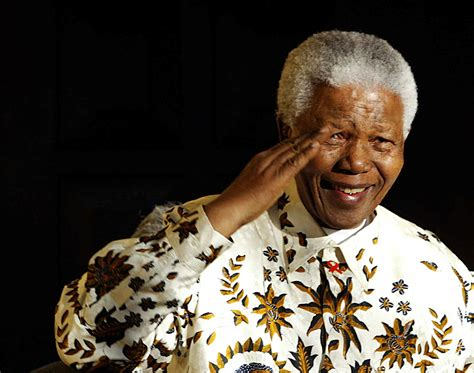 Former South African President Nelson Mandela salutes the ...