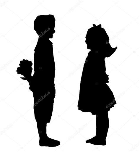 Fotos de Un niño y una niña con silueta de flores   Imagen ...