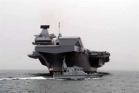 Grey dwarf  as patrol boats are overshadowed by HMS Queen ...
