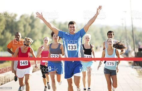 Group Of Runners Finishing The Race Stock Photo   Download ...
