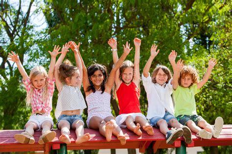 Happy Kids Raising Hands Outdoors. Stock Image   Image of ...