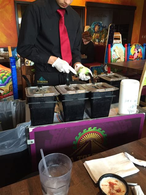 He is making fresh guacamole is front of us. Avocados ...
