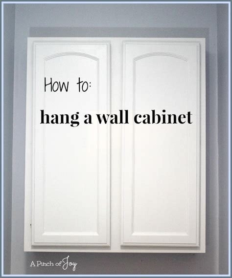 How to hang a wall cabinet the easy way | | A Pinch of Joy