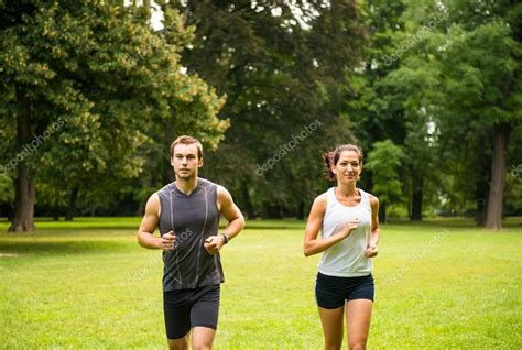 Jogging together   young couple running — Stock Photo ...