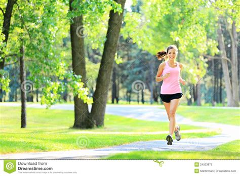 Jogging Woman Running In Park Stock Photo   Image: 24523876