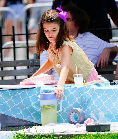 Katie Holmes  Daughter Suri Sells Lemonade at N.Y.C. Pride ...